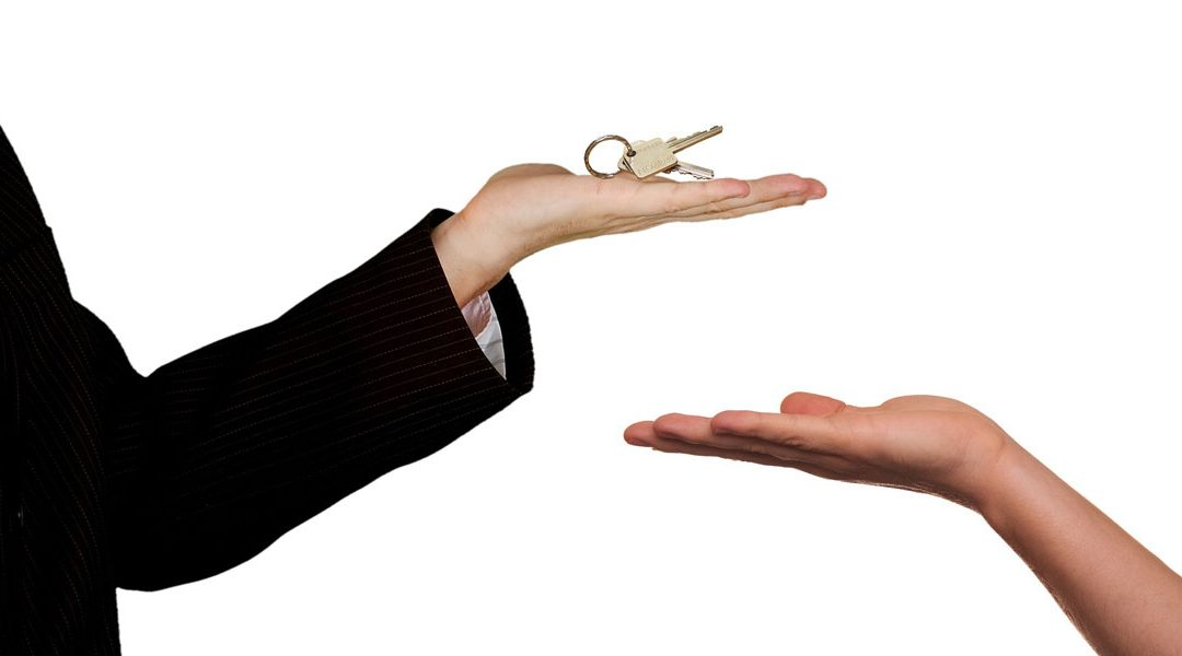 Seller handing over keys